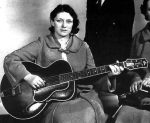 Maybelle Carter with an archtop guitar