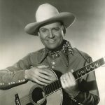 Gene Autry with an acoustic guitar