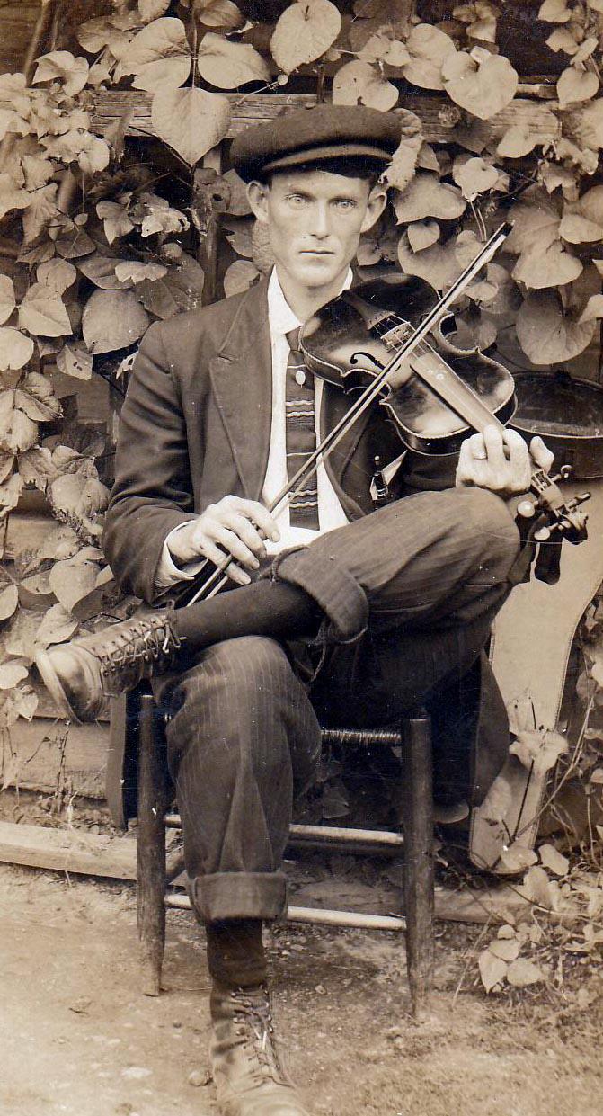 Fiddler in Garden courtesy of Shlomo Pestcoe NEW